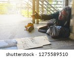 homeless man is lie down on... | Shutterstock . vector #1275589510