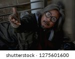 homeless man is lie down on... | Shutterstock . vector #1275601600
