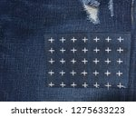 legs torn jeans fabric with a... | Shutterstock . vector #1275633223