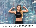 portrait of fitness young woman ... | Shutterstock . vector #1275639220