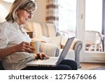 senior woman holding a cup of... | Shutterstock . vector #1275676066