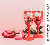 stemware  ring in box and rose... | Shutterstock . vector #1275707656