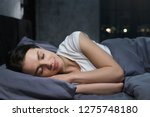 young female sleeping... | Shutterstock . vector #1275748180