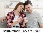 happy couple looking at...   Shutterstock . vector #1275753700