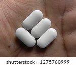 many white medicine tablets on... | Shutterstock . vector #1275760999