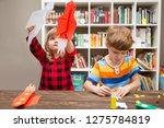 two preschool children in... | Shutterstock . vector #1275784819