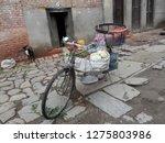 a parked vegetable seller's...   Shutterstock . vector #1275803986