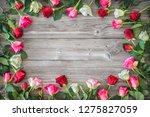 roses on wooden board.... | Shutterstock . vector #1275827059