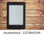 a blank e reader on a old desk...   Shutterstock . vector #1275841549