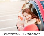 happy smaile asian woman driver ... | Shutterstock . vector #1275865696