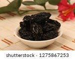 prunes in white glass bowl on... | Shutterstock . vector #1275867253