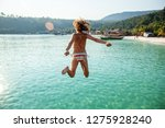 young beautiful woman in bikini ... | Shutterstock . vector #1275928240