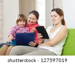 two women and child  looks... | Shutterstock . vector #127597019