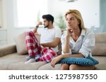 worried couple having problems... | Shutterstock . vector #1275987550