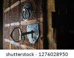 Big Key In Rustic Door Of...