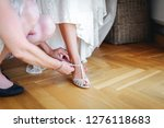 bridal shoes at a wedding | Shutterstock . vector #1276118683