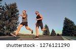 the two sportsmen running on...   Shutterstock . vector #1276121290