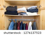 sagging shelf with lots of... | Shutterstock . vector #1276137523