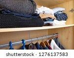 wardrobe shelf with abundance... | Shutterstock . vector #1276137583