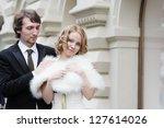 happy bride and groom outdoors | Shutterstock . vector #127614026