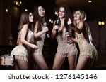 beautiful women singing karaoke ... | Shutterstock . vector #1276145146