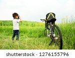 asian boy taking photo of...   Shutterstock . vector #1276155796