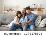 cheerful family vloggers with... | Shutterstock . vector #1276178926