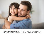 hopeful single dad embracing... | Shutterstock . vector #1276179040