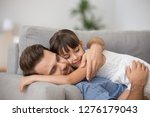 happy father hugging cute... | Shutterstock . vector #1276179043