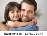 happy little kid hugging dad... | Shutterstock . vector #1276179049