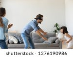 blindfolded father playing hide ... | Shutterstock . vector #1276190986