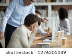 Small photo of Stressed employee intern suffering from gender discrimination or unfair criticism of angry male boss shouting scolding firing female worker for bad work, computer mistake or incompetence in office