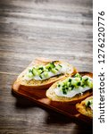 bruschettas on cutting board on ... | Shutterstock . vector #1276220776