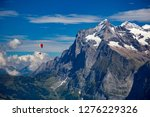 a para glider soars above the...   Shutterstock . vector #1276229326