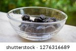 black olives in a glass bowl.... | Shutterstock . vector #1276316689