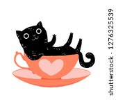 Stock vector cute cartoon black cat lying in a tea cup with a heart on it valentine s day greeting card 1276325539
