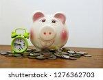 piggy saving money on coins...   Shutterstock . vector #1276362703