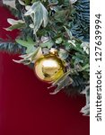 Christmas Decoration on Red Door - stock photo