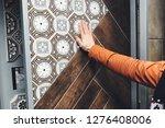 man's hand in orange vest on... | Shutterstock . vector #1276408006
