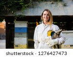 beekeeper in front of her bee... | Shutterstock . vector #1276427473