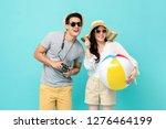 lovely asian couple in summer... | Shutterstock . vector #1276464199