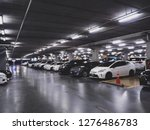 indoor full modern parking lot... | Shutterstock . vector #1276486783