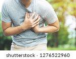 man having chest pain   heart... | Shutterstock . vector #1276522960