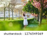 happy young woman in white... | Shutterstock . vector #1276549369