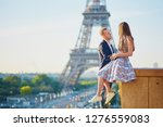 romantic couple near the eiffel ... | Shutterstock . vector #1276559083