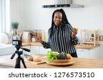 happy african american woman... | Shutterstock . vector #1276573510
