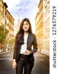 smiling asian business woman... | Shutterstock . vector #1276579219