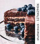 chocolate cake with fresh... | Shutterstock . vector #1276629406