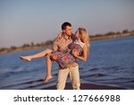 happy couple on the beach | Shutterstock . vector #127666988