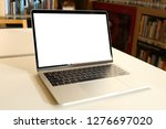 laptop mockup on white desk... | Shutterstock . vector #1276697020
